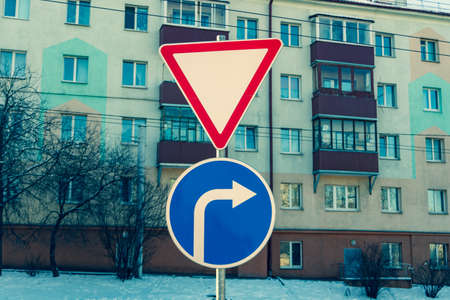Road sign turn right and give way cinematic Stockfoto