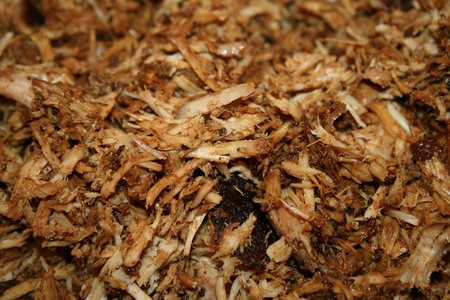 slow cooker: pork bbq (pork barbecue) cooked, shredded and ready to eat