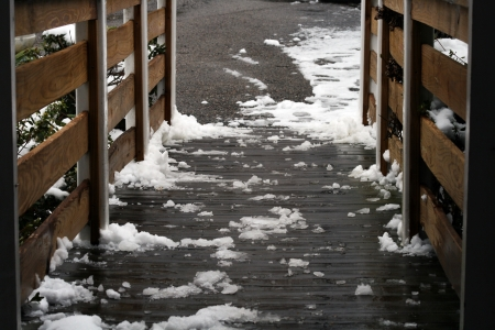 Dangerous   Icy handicap ramp and partial view of icy driveway Imagens