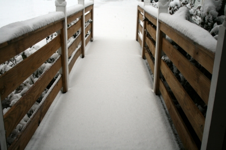 Beautiful snow covered handicap ramp photo