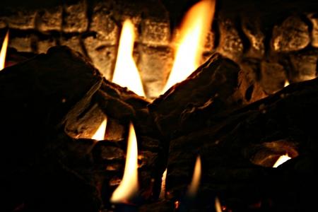 dimly: a dimly lit fireplace Stock Photo