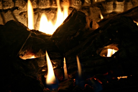 fire pit: Lots of huge flames burning brightly among the logs show of some great background texture of the wood giving the viewer the feeling of being in a firepit Stock Photo
