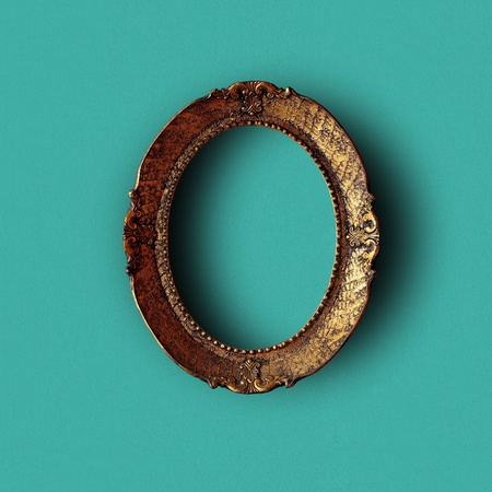 Antique art frame on green wall, hollow and with shadows. Included paths for cutting. Stock Photo - 8922437