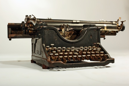 out of production: Vintage Grungy Tarnished and  Grimed Typing Machine Stock Photo