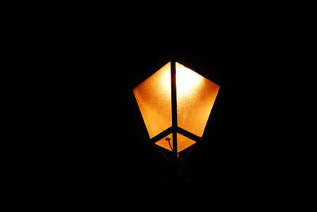 One old orange lamp torch at night