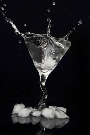 martini drink splash on black background photo