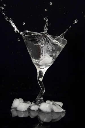 martini drink splash on black background photo