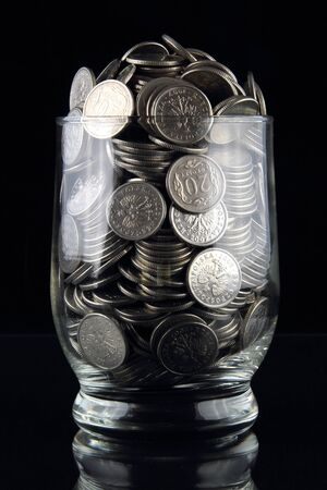 coins in glass photo