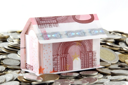 house built with euro coins and banknotes