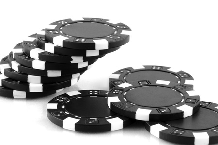 black poker chips on white background photo