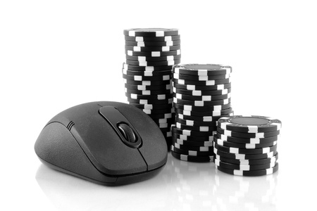 Online gaming and gambling concept, a mouse and black casino chips on white background photo