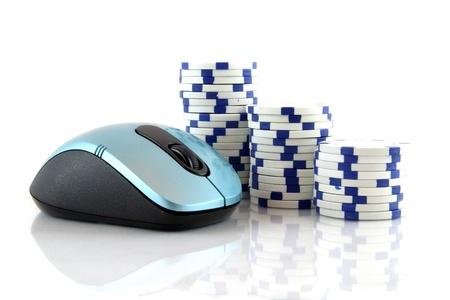 Online gaming and gambling concept, a mouse and blue casino chips on white background
