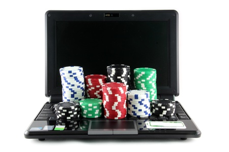 Online gaming and gambling concept, laptop and casino chips on keyboard Imagens