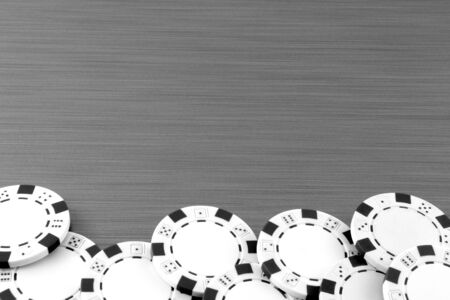 Poker chips on stainless steel background photo