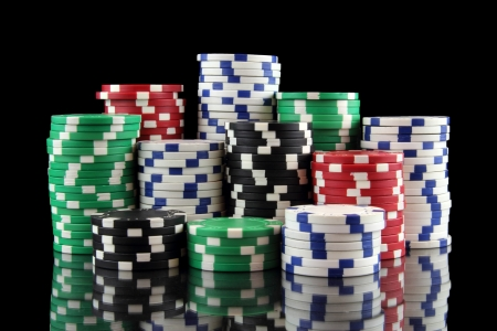 stack of casino gambling chips on black background 写真素材