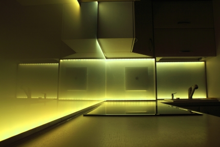 modern luxury kitchen with yellow led lighting