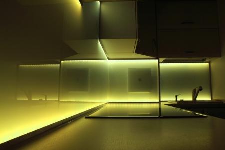 modern luxury kitchen with yellow led lighting