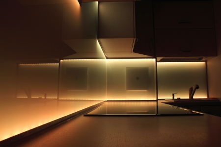 modern luxury kitchen with yellow led lighting photo
