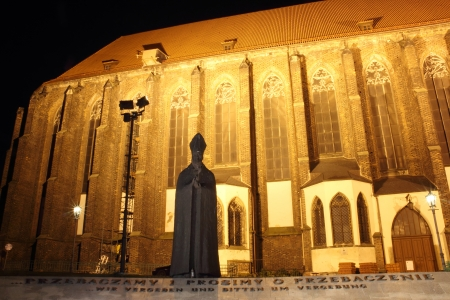 Cardinal Boleslaw Kominek Monument at night, Sand Island, Wroclaw, Poland photo