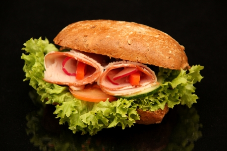 ham sandwich on black background photo