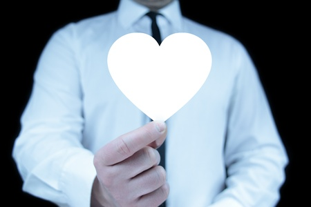 Businessman with heart icon Stock Photo - 17957584