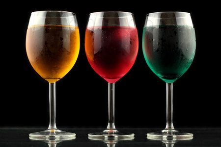 happyhour: closeup of some glasses with cocktails of different colors in nightclub Stock Photo