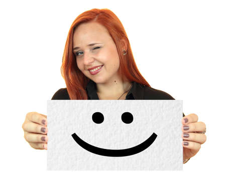 Smile  Smiling young woman holding up white banner  Stock Photo - 21703298