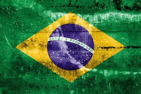 Brazil flag on old grunge wall background photo