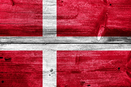 Denmark Flag painted on old wood plank background photo