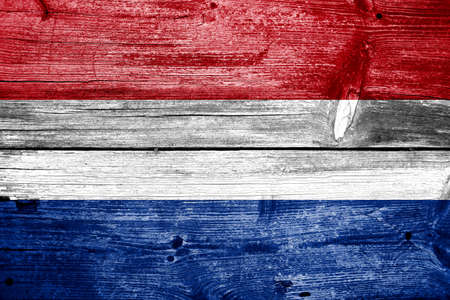Netherlands Flag painted on old wood plank background photo