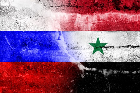 Russia and Syria Flag painted on grunge wall photo