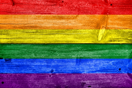 gay symbol: Rainbow Flag painted on old wood plank background