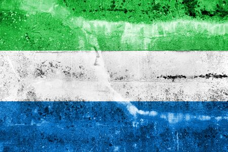 Sierra Leone Flag painted on grunge wall photo