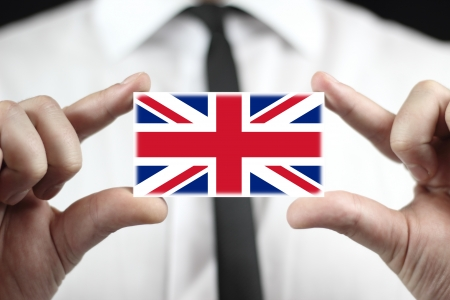 Businessman holding a business card with a UK Flag