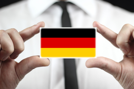 Businessman holding a business card with a Germany Flag photo