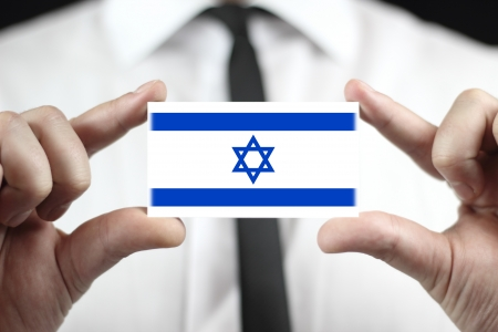 Businessman holding a business card with a Israel Flag photo