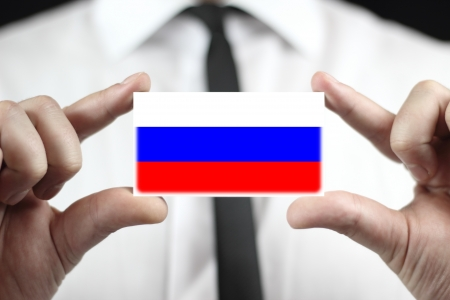 Businessman holding a business card with a Russia Flag photo