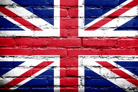 UK Flag painted on old brick wall photo