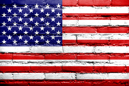 USA Flag painted on old brick wall Stock Photo