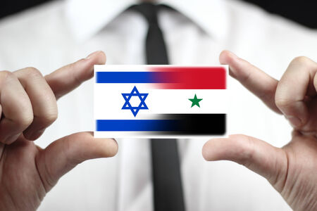 ess: Businessman holding a business card with Israel and Syria Flag