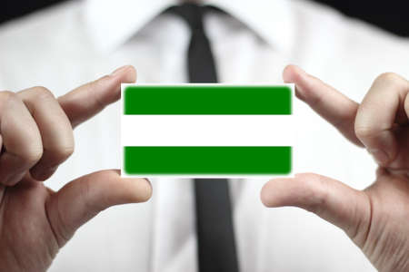rotterdam: Businessman holding a business card with Rotterdam City Flag