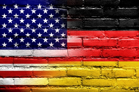 USA and Germany Flag painted on brick wall photo