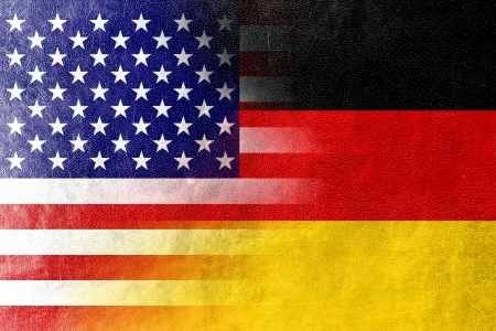 german culture: USA and Germany Flag painted on leather texture Stock Photo