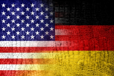 USA and Germany Flag painted on luxury crocodile texture photo