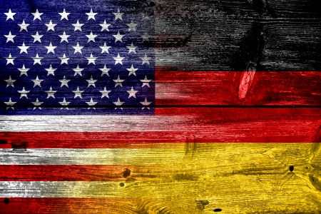 USA and Germany Flag painted on old wood plank texture