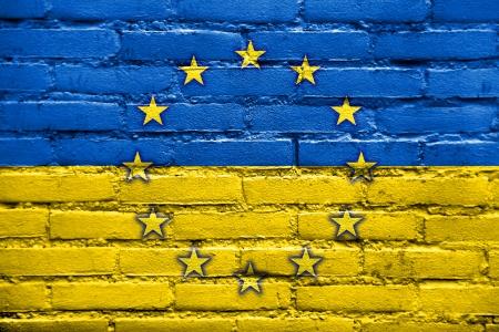 EU and Ukraine Flag painted on brick wall