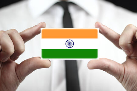 indian professional: Businessman holding a business card with India Flag