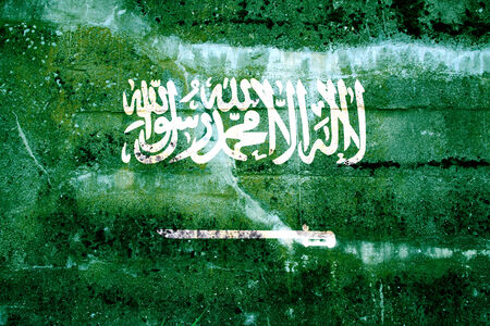sheik: Saudi Arabia Flag painted on grunge wall Stock Photo