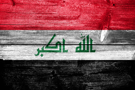 iraq flag: Iraq Flag painted on old wood plank texture Stock Photo