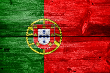 Portugal Flag painted on old wood plank texture photo